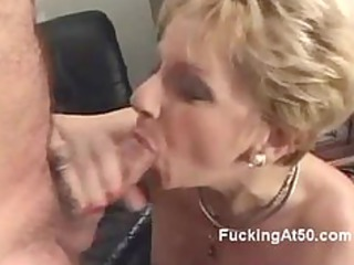concupiscent golden-haired granny blows a pecker
