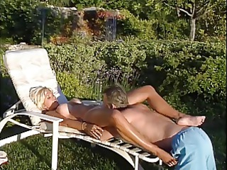 aged blonde lifeguard gets her big tits licked by