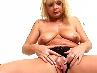 older blond rosalyn plays with herself in the