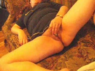 wife masturbates to orgasm on couch