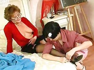 juvenile girl kisses and licks aged woman