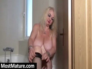 granny with large tits undresses fishnets