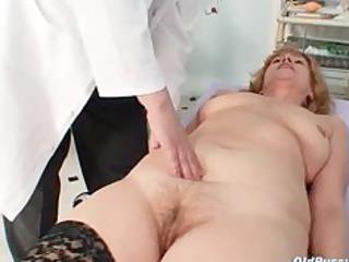 redhead ribald pussy stretching in gyn clinic