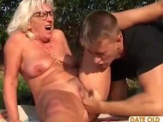 romanian bushy granny with young lad