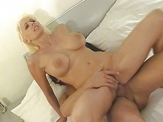 heavy chested blonde milf rides hard tool in