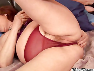 plump granny probes her old cunt with a sex-toy