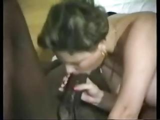 white wife pleasing her darksome bull