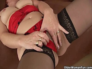 excited granny in stockings is dildoing her bushy