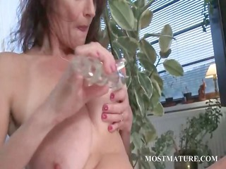 slutty aged engulfing and fucking dildo