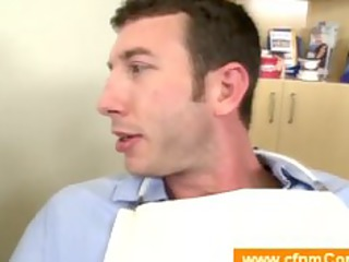 male dentist undresses a boy