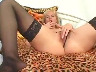 older blond on couch masturbates her slit