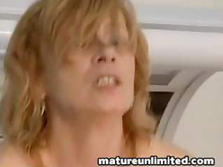 at the tanning salon a babe milf receives a