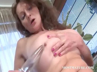 sexually excited older engulfing and fucking dildo