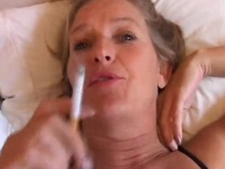 mature sweetheart enjoys a smoke and a jerk off