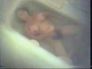 bushy mamma masturbating in baths tube.