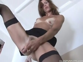 delicious mature red head in stockings
