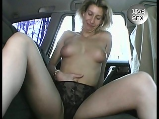 mature amateur masturbates herself in a car