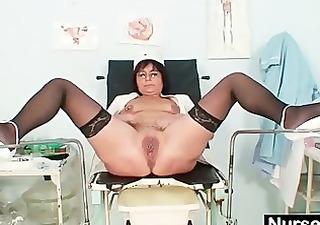 old slut toys her pierced cookie on gynochair