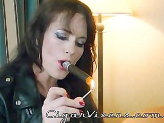 sherry stunns smokes a cigar