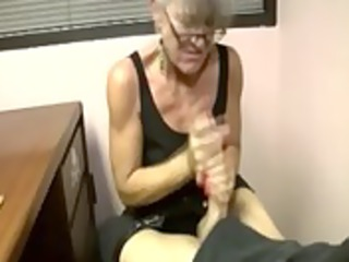 granny sucks and tugs this favourable boy and