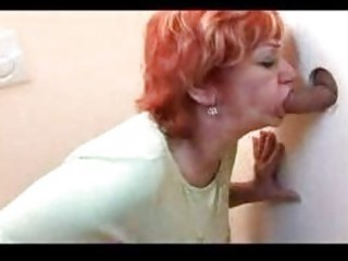 redhead aged group-fucked throughout gloryhole
