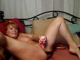 american milf takes various toys in the ass