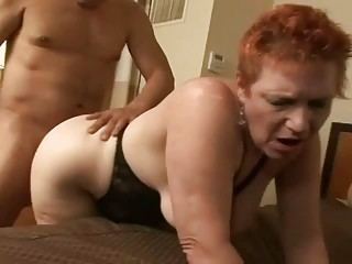 redhead granny getting her cunt pounded on a sofa
