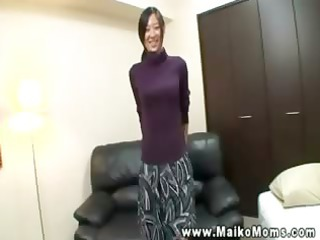 young aged oriental gives a worthy striptease