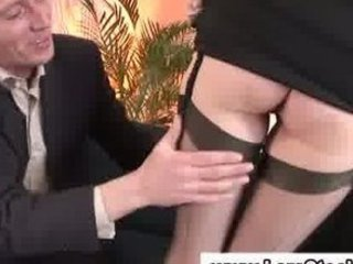 older chick in nylons shows off her legs to a lad