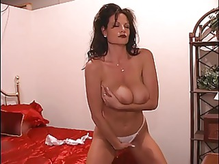 a brunette hair milf with an astonishing pair of