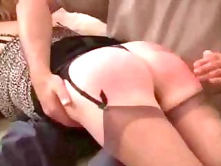 mature woman gets her tushie spanked to a bright