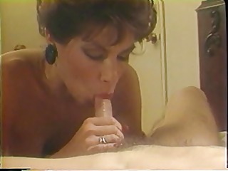 older golden-haired sucks on a big white cock in