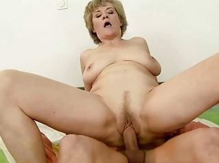 breasty grandma enjoys sex with youthful stud