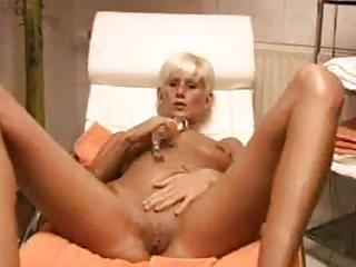 blond milf masturbates