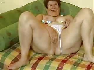 breasty granny masturbates in front of webcam