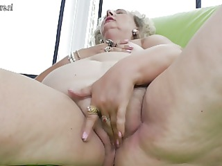 old grandma playing with a purple dildo