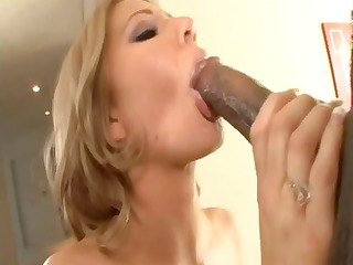 busty golden-haired milf munches on dark rod and