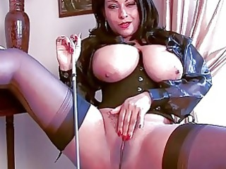 arousing brunette hair momma in corset and nylons