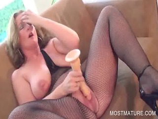 wicked mature fucking a big vibrator