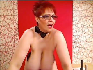 obese redhead on her cam shows her big melons and