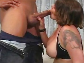 enormous chested milf bunette with tattoo does