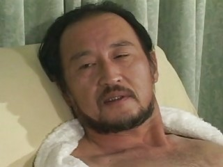 older oriental guy all alone at home
