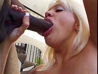 blond mouth drains a biggest darksome weenie