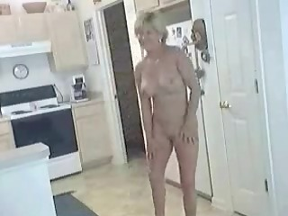 aged hot mommy in natures garb in kitchen showing