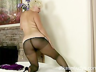 mother i kelly plays with her nylon pantyhose