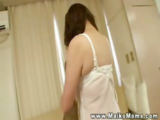oriental older tramp shows her body then massages